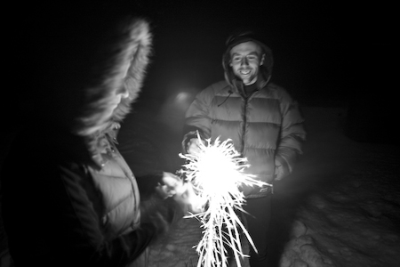 Nan Maxson and David Parsons with sparklers.